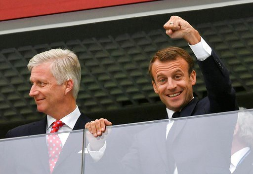 (AP Photo/Martin Meissner). French President Emmanuel Macron, right, clenches a fist as he stands beside King Philippe of Belgium prior to the semifinal match between France and Belgium at the 2018 soccer World Cup in the St. Petersburg Stadium in St. ...