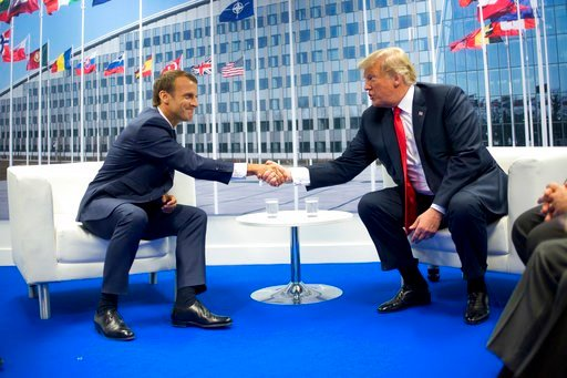 (AP Photo/Pablo Martinez Monsivais). President Donald Trump and French President Emmanuel Macron shake hands during their bilateral meeting, Wednesday, July 11, 2018 in Brussels, Belgium.