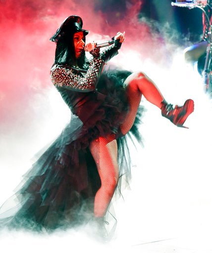 (Photo by Chris Pizzello/Invision/AP, File). FILE - In this March 11, 2018 file photo, Cardi B performs during the 2018 iHeartRadio Music Awards in Inglewood, Calif. The 25-year-old rapper welcomed Kulture Kiari Cephus during a post on Instagram Wednes...