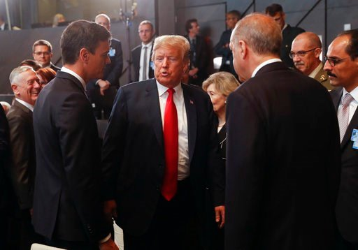 (AP Photo/Pablo Martinez Monsivais/pool). President Donald Trump, center, stops to talk with Spanish Prime Minister Pedro Sanchez, left, and Turkey's President Recep Tayyip Erdogan, right, as they attend a meeting of the North Atlantic Council during a...