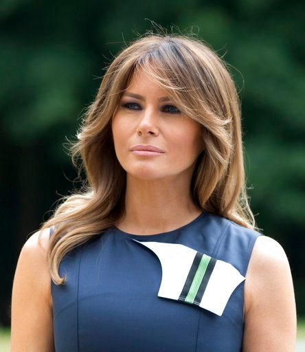 (AP Photo/Virginia Mayo). U.S. first lady Melania Trump waits for other spouses prior to a group photo at the Queen Elisabeth Music Chapel in Waterloo, Belgium, during a spouses program on the sidelines of the NATO summit on Wednesday, July 11, 2018.