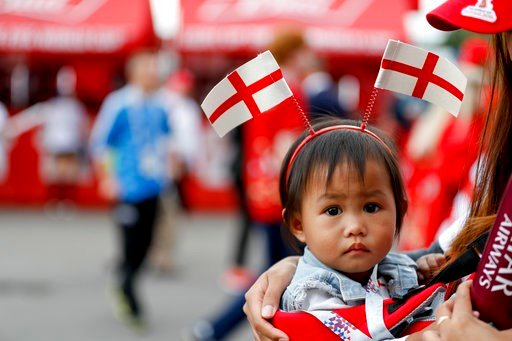 (AP Photo/Rebecca Blackwell). A child arrives for the semifinal match between Croatia and England at the 2018 soccer World Cup in the Luzhniki Stadium in Moscow, Russia, Wednesday, July 11, 2018.