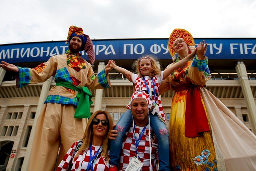 (AP Photo/Rebecca Blackwell). Croatia fans pose for a picture before the semifinal match between Croatia and England at the 2018 soccer World Cup in the Luzhniki Stadium in Moscow, Russia, Wednesday, July 11, 2018.