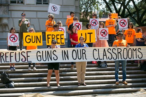 (Ralph Barrera/Austin American-Statesman via AP, File). FILE - In this Oct. 1, 2015, file photo, protesters gather on the West Mall of the University of Texas campus, in Austin, to oppose a new state law that expands the rights of concealed handgun lic...