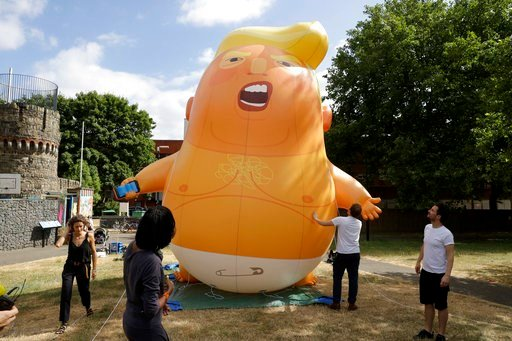 (AP Photo/Matt Dunham). In this photo taken on Tuesday, July 10, 2018,  a six-meter high cartoon baby blimp of U.S. President Donald Trump stands inflated during a practice session in Bingfield Park, north London. Trump will get the red carpet treatmen...
