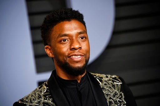 (Photo by Evan Agostini/Invision/AP, File). FILE - In this March 4, 2018 file photo, Chadwick Boseman arrives at the Vanity Fair Oscar Party in Beverly Hills, Calif. STX Entertainment announced Wednesday, July 11, 2018, that Boseman will star as a disg...