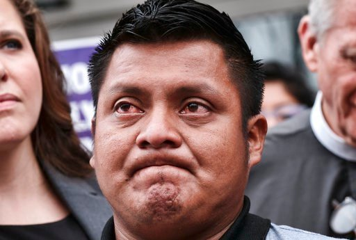 (AP Photo/Richard Vogel). Hermelindo Che Coc, of Guatemala, holds back tears prior to a required check-in with immigration enforcement authorities in Los Angeles on Tuesday, July 10, 2018. Che Coc says his 6-year-old son feared he was dead after U.S. a...
