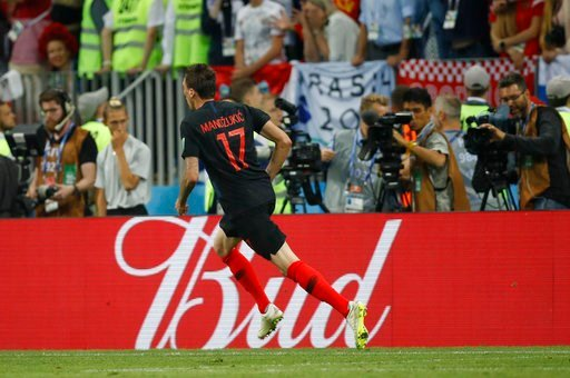 (AP Photo/Francisco Seco). Croatia's Mario Mandzukic celebrates after scoring his side's second goal during the semifinal match between Croatia and England at the 2018 soccer World Cup in the Luzhniki Stadium in Moscow, Russia, Wednesday, July 11, 2018.