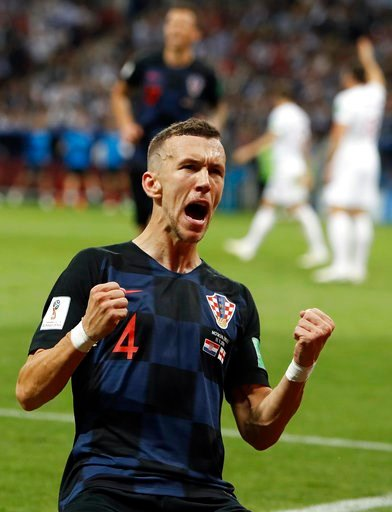 (AP Photo/Alastair Grant). Croatia's Ivan Perisic celebrates after scoring his side's first goal during the semifinal match between Croatia and England at the 2018 soccer World Cup in the Luzhniki Stadium in Moscow, Russia, Wednesday, July 11, 2018.
