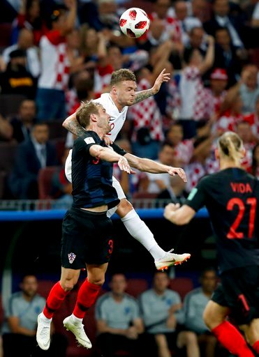 (AP Photo/Rebecca Blackwell). England's Kieran Trippier, right, challenges for the ball with Croatia's Ivan Strinic during the semifinal match between Croatia and England at the 2018 soccer World Cup in the Luzhniki Stadium in Moscow, Russia, Wednesday...