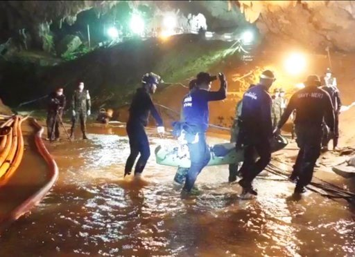 (Thai NavySEAL Facebook Page via AP). This undated from video released via the Thai NavySEAL Facebook Page on Wednesday, July 11, 2018, shows rescuers hold an evacuated boy inside the Tham Luang Nang Non cave in Mae Sai, Chiang Rai province, in norther...