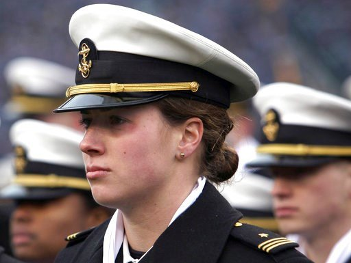 (AP Photo/Jacqueline Larma, File). FILE - In this Dec. 14, 2013 file photo, Navy women's soccer goalkeeper Elizabeth Hoerner stands in formation before the start of the Army Navy NCAA college football game at Lincoln Financial Field in Philadelphia. Th...