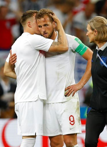 (AP Photo/Francisco Seco). England's Eric Dier hugs with England's Harry Kane, right, during the semifinal match between Croatia and England at the 2018 soccer World Cup in the Luzhniki Stadium in Moscow, Russia, Wednesday, July 11, 2018.