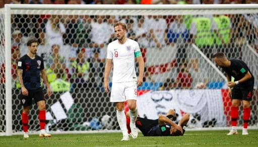 (AP Photo/Francisco Seco). England's Harry Kane grimaces during the semifinal match between Croatia and England at the 2018 soccer World Cup in the Luzhniki Stadium in Moscow, Russia, Wednesday, July 11, 2018.