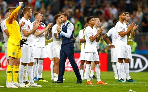 (AP Photo/Matthias Schrader). England head coach Gareth Southgate walks between his players disappointed after losing the semifinal match between Croatia and England at the 2018 soccer World Cup in the Luzhniki Stadium in Moscow, Russia, Wednesday, Jul...