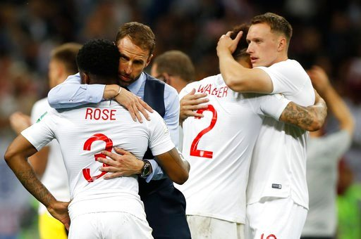 (AP Photo/Francisco Seco). England head coach Gareth Southgate, 2nd left, comforts England's Danny Rose, left, after loosing the semifinal match between Croatia and England at the 2018 soccer World Cup in the Luzhniki Stadium in Moscow, Russia, Wednesd...