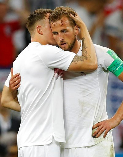 (AP Photo/Francisco Seco). England's Phil Jones hugs with England's Harry Kane, right, during the semifinal match between Croatia and England at the 2018 soccer World Cup in the Luzhniki Stadium in Moscow, Russia, Wednesday, July 11, 2018.