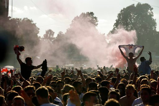 (AP Photo/Matt Dunham). England soccer fans celebrates first goal as they watch a live broadcast on a big screen of the semifinal match between Croatia and England at the 2018 soccer World Cup, in Hyde Park, London, Wednesday, July 11, 2018.