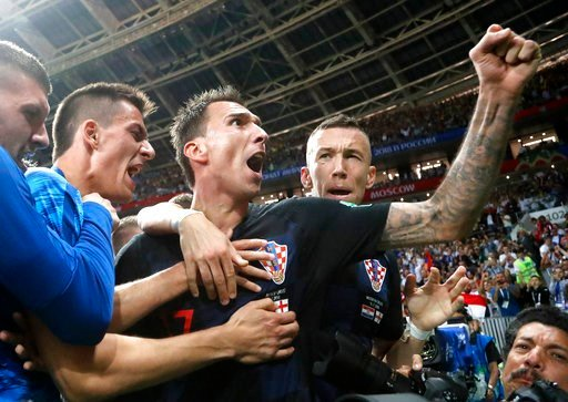 (AP Photo/Frank Augstein). Croatia's Mario Mandzukic, center, celebrates after scoring his side's second goal during the semifinal match between Croatia and England at the 2018 soccer World Cup in the Luzhniki Stadium in Moscow, Russia, Wednesday, July...