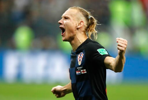 (AP Photo/Frank Augstein). Croatia's Domagoj Vida celebrates after his team advanced to the final during the semifinal match between Croatia and England at the 2018 soccer World Cup in the Luzhniki Stadium in Moscow, Russia, Wednesday, July 11, 2018.