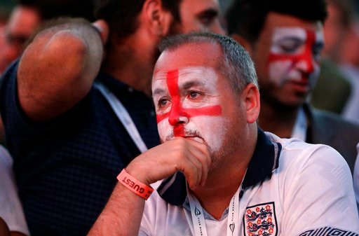 (AP Photo/Matt Dunham). An England soccer fan reacts after Croatia scored their side's second goal as he watches a live broadcast on a big screen of the semifinal match between Croatia and England at the 2018 soccer World Cup, in Hyde Park, London, Wed...
