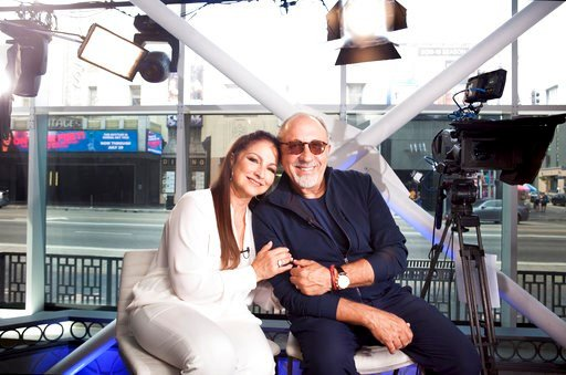 "(Photo by Rebecca Cabage/Invision/AP). In this July 9, 2018 photo, Gloria and Emilio Estefan pose for a portrait at BiteSize Studio in Los Angeles to promote their touring musical ""On Your Feet!."""