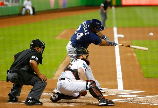 (AP Photo/Wilfredo Lee). Milwaukee Brewers' Jesus Aguilar hits a double, scoring Eric Thames during the first inning of the teams baseball game against the Miami Marlins, Wednesday, July 11, 2018, in Miami.