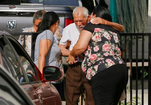 (AP Photo/Damian Dovarganes). Aurelia Rodriguez, second left, Rodolfo Rodriguez, 92, center, greets witness, Misbel Borjas, right, as he walks to talk to the media outside his home in Los Angeles Wednesday, July 11, 2018. Rodolfo Rodriguez was out for ...