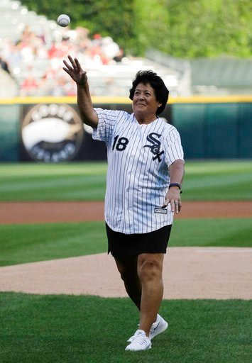 (AP Photo/Nam Y. Huh). Former LPGA golfer Nancy Lopez throws out a ceremonial first pitch before a baseball game between the St. Louis Cardinals and the Chicago White Sox in Chicago, Wednesday, July 11, 2018.