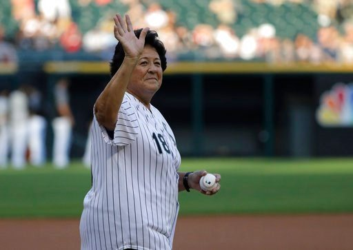 (AP Photo/Nam Y. Huh). Former LPGA golfer Nancy Lopez waves before throwing a ceremonial first pitch before a baseball game between the St. Louis Cardinals and the Chicago White Sox in Chicago, Wednesday, July 11, 2018.
