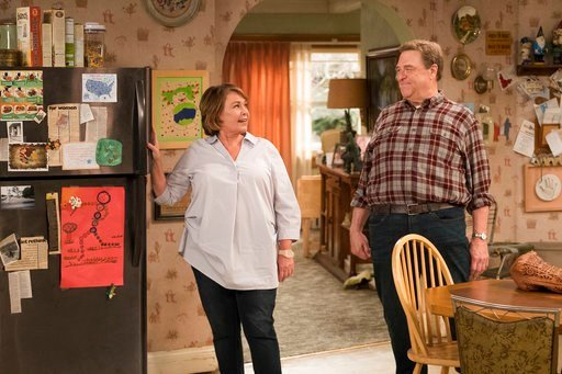 "(Adam Rose/ABC via AP). This image released by ABC shows Roseanne Barr, left, and John Goodman in a scene from the comedy series ""Roseanne."""
