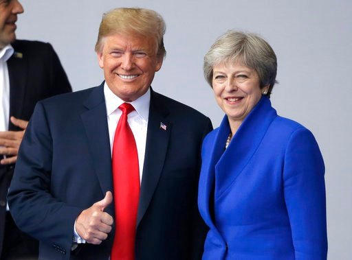 (AP Photo/Markus Schreiber). In this July 11, 2018, photo, U.S. President Donald Trump, left, talks to British Prime Minister Theresa May during a summit of heads of state and government at NATO headquarters in Brussels. Trump is all in for Winston Chu...