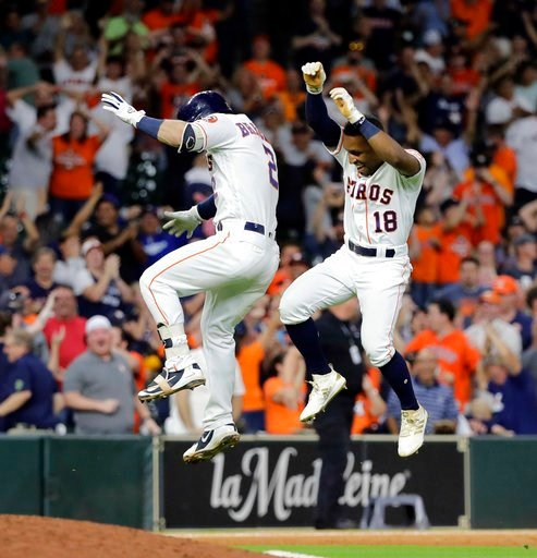 (AP Photo/David J. Phillip). Houston Astros' Tony Kemp (18) and Alex Bregman (2) celebrate after the team's baseball game against the Oakland Athletics on Tuesday, July 10, 2018, in Houston. The Astros won 6-5.