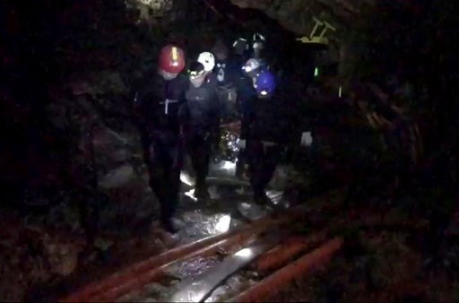 (Thai NavySEAL Facebook Page via AP). This undated photo from video released via the Thai NavySEAL Facebook Page on Wednesday, July 11, 2018, shows rescuers hold an evacuated boy inside the Tham Luang Nang Non cave in Mae Sai, Chiang Rai province.