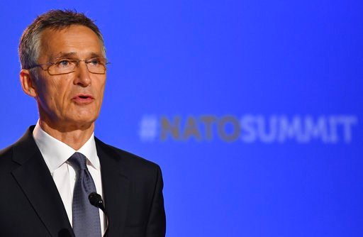 (AP Photo/Geert Vanden Wijngaert). NATO Secretary-General Jens Stoltenberg speaks at a press conference during a summit of heads of state and government at NATO headquarters in Brussels, Belgium, Thursday, July 12, 2018. NATO leaders gather in Brussels...