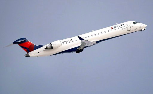 (AP Photo/Charles Krupa, File). FILE- In this Jan. 8, 2018, file photo, a Delta Air Lines Connection regional jet operated by GoJet Airlines takes off from Logan International Airport in Boston. Delta Air Lines reports earns on Thursday, July 12.