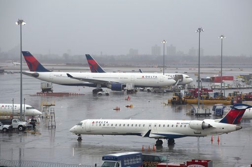 (AP Photo/Mark Lennihan, File). FILE- In this March 2, 2018, file photo, Delta Air Lines planes are grounded in New York. Delta Air Lines reports earns on Thursday, July 12.