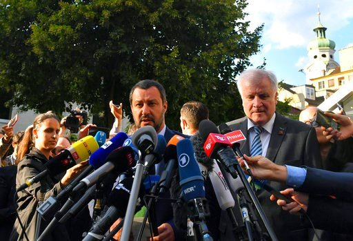 (AP Photo/Kerstin Joensson). Italy's Interior Minister Matteo Salvini, left, and his German counterpart Horst Seehofer speak to media after a meeting in Innsbruck, Austria, on Wednesday, July 11, 2018.