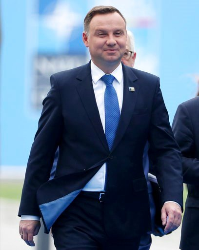 (Tatyana Zenkovich/pool photo via AP). Polish President Andrzej Duda arrives for the second day of a summit of heads of state and government at NATO headquarters in Brussels, Belgium, Thursday, July 12, 2018. NATO leaders gather in Brussels for a two-d...