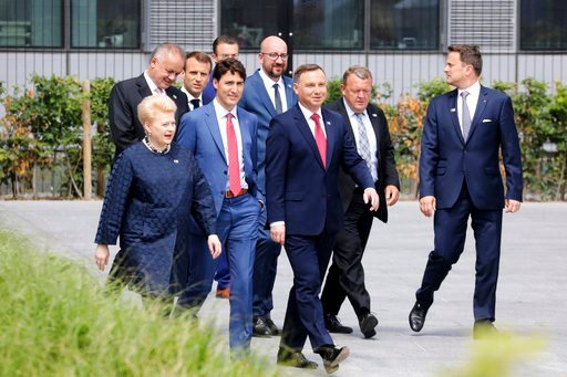 (Ludovic Marin, Pool via AP). First row from the left, Lituania's President Dalia Grybauskaite, Canada's Prime Minister Justin Trudeau, Poland's President Andrzej Duda, Denmark's Prime Minister Lars Lokke Rasmussen, Luxembourg's Prime Minister Xavier B...