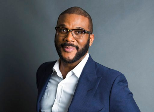 "(Photo by Amy Sussman/Invision/AP, File). FILE - In this Nov. 16, 2017, file photo, actor-filmmaker and author Tyler Perry poses for a portrait in New York to promote his book, ""Higher Is Waiting."" Perry is warning fans not to be scammed. The actor, co..."