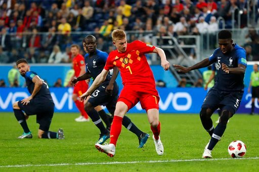 (AP Photo/Frank Augstein). Belgium's Kevin De Bruyne, center, and France's Samuel Umtiti challenge for the ball during the semifinal match between France and Belgium at the 2018 soccer World Cup in the St. Petersburg Stadium in, St. Petersburg, Russia,...