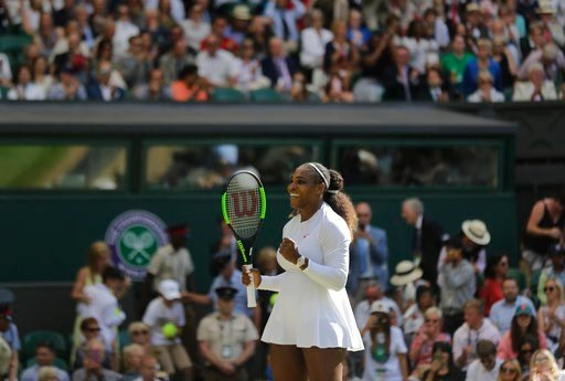 (AP Photo/Ben Curtis). Serena Williams of the United States celebrates winning her women's singles quarterfinals match against Italy's Camila Giorgi, at the Wimbledon Tennis Championships, in London, Tuesday July 10, 2018.