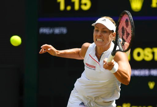 (Neil Hall/Pool via AP). Angelique Kerber of Germany returns the ball to Jelena Ostapenko of Latvia during their women's semifinal match at the Wimbledon Tennis Championships in London, Thursday July 12, 2018.