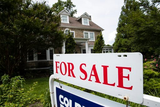 (AP Photo/Matt Rourke). In this June 8, 2018, photo a for sale sign stands in front of a house, in Jenkintown, Pa. On Thursday, July 12, Freddie Mac reports on the week's average U.S. mortgage rates.