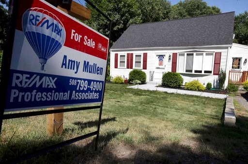 (AP Photo/Steven Senne). In this Monday, July 9, 2018, photo a for sale sign stands outside a pre-existing home, in Walpole, Mass. On Thursday, July 12, Freddie Mac reports on the week's average U.S. mortgage rates.