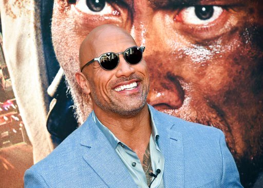 "(Photo by Evan Agostini/Invision/AP, File). FILE - In this July 10, 2018 file photo, Actor Dwayne Johnson attends the ""Skyscraper"" premiere in New York. Johnson, who plays an amputee in the action movie, said Thursday, July 12, he is joining the Boston..."
