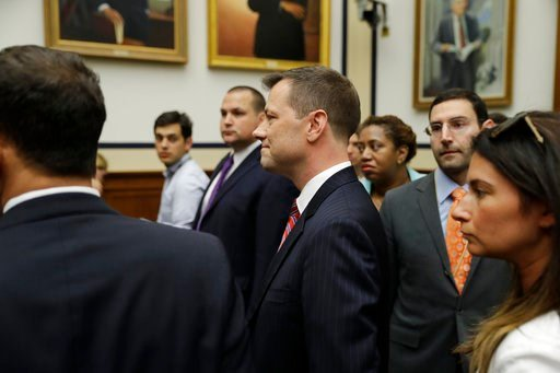 """(AP Photo/Evan Vucci). FBI Deputy Assistant Director Peter Strzok, center, arrives before the House Committees on the Judiciary and Oversight and Government Reform hearing on """"Oversight of FBI and DOJ Actions Surrounding the 2016 Election,"""" on Capitol ..."""