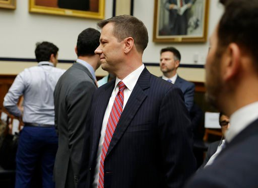 """(AP Photo/Evan Vucci). FBI Deputy Assistant Director Peter Strzok, center, arrives to a hearing of the House Committees on the Judiciary and Oversight and Government Reform on """"Oversight of FBI and DOJ Actions Surrounding the 2016 Election,"""" on Capitol..."""