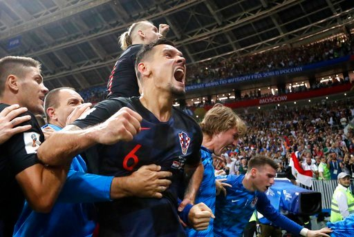 (AP Photo/Frank Augstein). Croatia's Dejan Lovren celebrates after Croatia's Mario Mandzukic scored his side's second goal during the semifinal match between Croatia and England at the 2018 soccer World Cup in the Luzhniki Stadium in Moscow, Russia, We...
